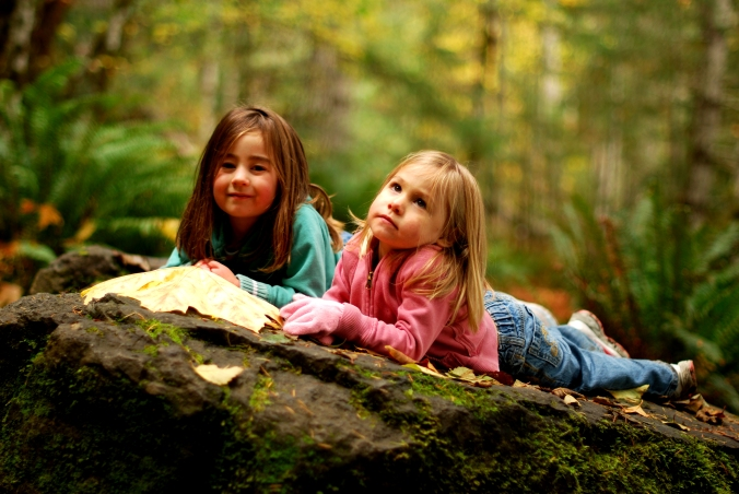 Kariya and Taryn taking a break on a moss-covered rock